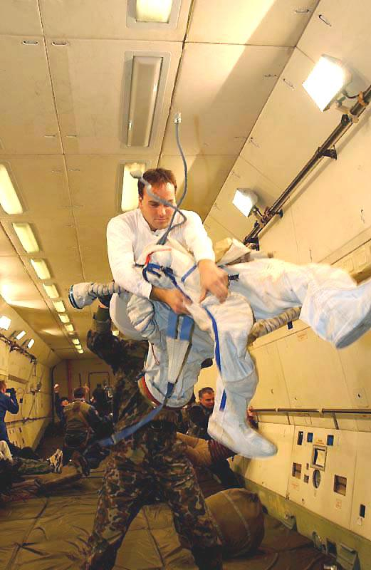 Donning a Space Suit in Weightlessness
